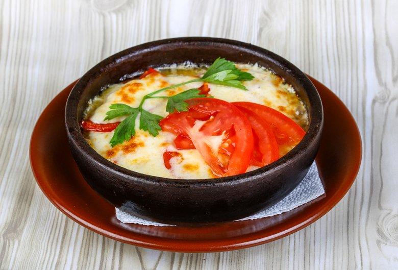 Schnitzel mit Bier und Käse überbacken